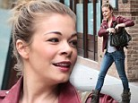 Not even LeAnn Rimes' heavy make-up can hide her puffy eyes after emotional week