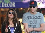 A very sweet couple: Dressed down Mila Kunis and Ashton Kutcher cool off with an ice cream treat