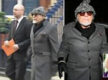 Gary Glitter arrives back home after a day at the police station