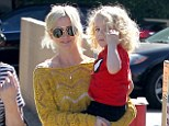 Moving on: Ashlee Simpson managed a smile as she stepped out with her two-year-old son Bronx in Toluca Lake on Saturday, and appeared in better spirits following news of her parents' divorce