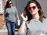 Keeping you up all night? New mum Drew Barrymore dons sunglasses and sips on coffee as she enjoys family day out