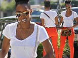 It's all in the jeans! Kelly Rowland is a striking sight in bright orange trousers which show off her long slim legs