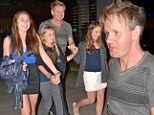 They're definitely Daddy's girls! Gordon Ramsay and his three daughters hold hands as they leave dinner