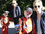 Halloween fun: Amy Poehler took her sons to a house party on Saturday to celebrate the season