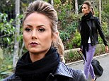 Not a diva just yet! Rock chick Stacy Keibler happily wheels her own suitcase as she jets off to Las Vegas