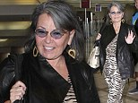 60 looks good on you! Roseanne Barr cuts a slimmer figure in tiger stripes at LAX
