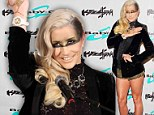 Ke$ha has no time for trousers as she slips into black and gold pants at watch unveiling