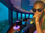 Let's hope he took a deep breath: Tinie Tempah performs at world's first underwater music club
