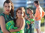 No trouble in paradise! Kourtney Kardashian plays happy families with boyfriend Scott Disick and son Mason for a day of fun at the beach