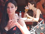 Monica Bellucci is just as glamorous away from the film set...as she wears a chic dress during lunch date with husband Vincent Cassel