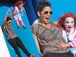 Her little Strawberry Shortcake! Halle Berry and dressed up daughter Nahla venture down the pumpkin patch slide together