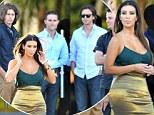 Start your engines boys! Kim Kardashian's golden 'assets' garner a lot of attention as she shops for $2 million car