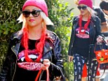 That is a scary outfit! Christina Aguilera wears tight skull-and-crossbone leggings to son Max's school parade