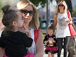 After a couple months out of town filming 'Scary Movie 5', Ashley Tisdale enjoyed her day in Toluca Lake with her niece Mikayla.