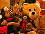 Mariah Carey... and the three bears: Singer dresses up as Goldilocks while Nick Cannon and twins turn wild for Halloween