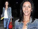 Liberty Ross courts attention in striking printed leggings as she joins celebs at basketball game (while Rupert stays home)