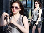 Actress Rose McGowan donned a pair of leather shorts as she visited an office block in Los Angeles on Thursday