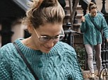 Braving the aftermath: Sarah Jessica Parker cracks a smile outside her West Village home after Hurricane Sandy
