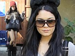 Halloween all day long: Vanessa Hudgens wears cat ears and a skeleton sweatshirt with sister Stella