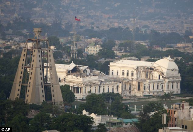 This photo taken from Fort National, a neighborhood of Port-au-Prince, shows the damage to the National Palace inflicted during the 2010 earthquake in Haiti