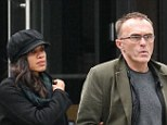 Braving the storm: Rosario Dawson and Danny Boyle look downbeat as they stroll around Manhattan in New York City on Wednesday