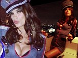 Attention! Sultry Elisabetta Canalis sports cleavage-baring General costume as she heads to Halloween party