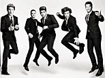 Jump around: One Direction look their suited best as they discuss their global fame with Vogue magazine