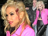 Take that Sandy! Gwen Stefani dresses as Grease star (complete with bullet wound) as she takes a light-hearted dig at Hurricane