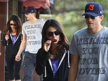 Ashton Kutcher and Mila Kunis take their relationship Down Under as they enjoy a trip to Sydney zoo