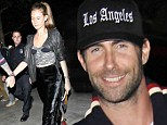 Something to smile about! Adam Levine is cheered up by crop top wearing model girlfriend Behati Prinsloo after Lakers defeat