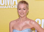 Simply stunning: Kellie Pickler showed her new regrown crop (she haved her head in solidarity with her best friend who has breast cancer) and glowed in plunging light blue gown as she arrived at the CMA Awards