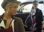 Traveling while she still can! Shakira shows off her growing baby bump as she makes her way through Barcelona airport