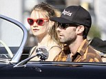Singer Adam Levine and his model girlfriend, Behati Prinsloo have some laughs