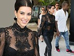Kim Kardashian is not the only one laughing... as she slips into frightful leather and lace outfit ahead of Halloween party