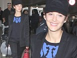 Absolutely flawless: Make-up free Marion Cotillard goes au naturel as she touches down at LAX