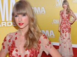 Lady in red: Taylor Swift wowed photographers at the CMA Awards