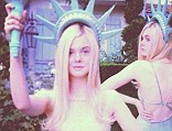 Elle Fanning dressed as the Statue of Liberty for Halloween this year