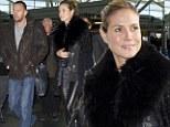 Back to business: Heidi Klum wears studded leather leggings as she arrives at JFK in New York with bodyguard boyfriend