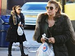 The pregnancy cravings are kicking in! Expectant mother Coleen Rooney pops to the garage to pick up some treats