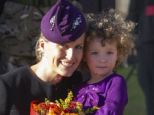 Cute: Three-year-old Sophie Lewis receives a hug after giving flowers to the Countess of Wessex