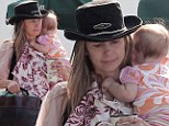 Juggling act: Mira Sorvino is pretty in pink and has her hands full while being seen out for first time with new baby