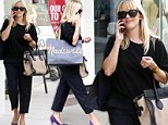 Solo shopping spree: Reese Witherspoon made a purchase at Madewell boutique in Century City, California, on Friday