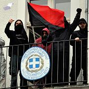 Demonstrators on the balcony of the Greek consulate in Berlin waved a black and red flag and threw leaflets.