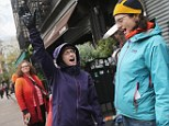 Hooray! HanaKyle Moran, pictured left, cheered shortly after power was restored in Manhattan's East Village