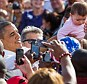 Barack Obama holds a baby aloft while on the campaign trail in Las Vegas, Nevada