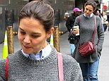 Showing the strain: Katie Holmes looked tired as she emerged in New York on Thursday after Superstorm Sandy