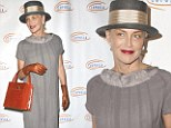 Bag lady: Sharon Stone looked a bit dowdy as she attended the Lupus LA Hollywood Bag Ladies Luncheon in Beverly Hills