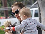 Supermum: Jennifer Garner takes son Samuel and a toy doll on a stroll through Brentwood, California