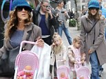 Sarah Jessica Parker's twin girls are quite the little mothers as they push their dolls along in matching strollers