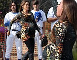 Sofia Vergara sings at a baseball game for Modern Family